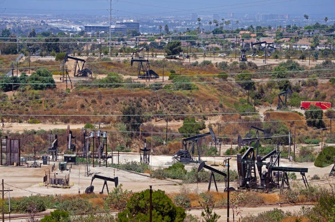 Pump jacks pull up oil and gas in Los Angeles County.