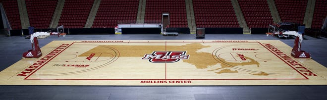 UMass's Mulleins Center. This court is covered with a giant outline of Massachusetts.