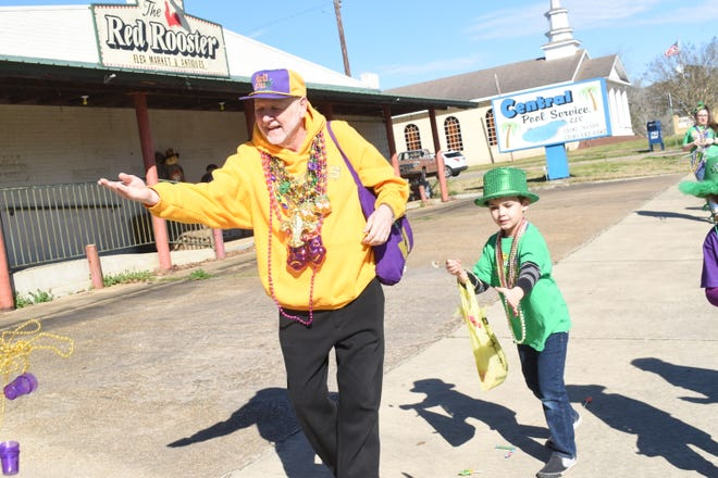 Mayor Jerome Scott  tosses beads in the 15th annual Children's Mardi Gras Parade in Pollock held Feb. 8, 2020. Scott passed away Friday. He was the longest serving mayor of Pollock with 17 years.