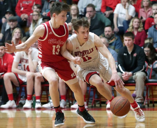 Hortonville's Mitch Tandeski (11) drives against Jackson Paveletzke of Kimberly during their Fox Valley Association boys basketball game Feb. 7 in Hortonville.