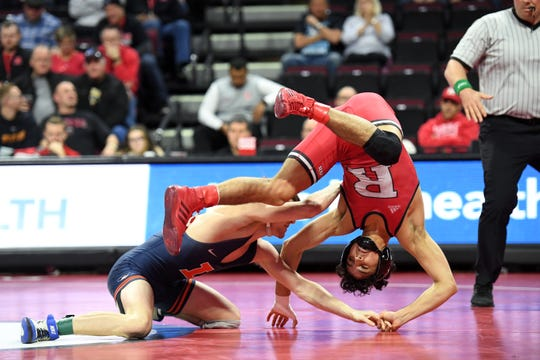 Illinois wrestling at Rutgers on Friday, February 7, 2020. (Right) Nic Aguilar, of Rutgers, and Justin Cardani, of Illinois, in their 125-pound match.