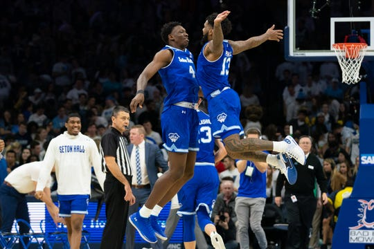 Seton Hall Pirates guard Myles Powell (13) celebrates with forward Tyrese Samuel (4) after scoring against the Villanova Wildcats