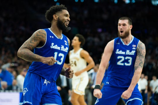 Seton Hall guard Myles Powell (13) smiles in front of forward Sandro Mamukelashvili (23) after a score against the Villanova Wildcats during the second half at Wells Fargo Center.
