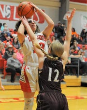 Albany senior Jaleigh Morales takes a shot over Hawley's Karrigan Parrott (12) on Friday, Feb. 7, 2020, at Albany High School.