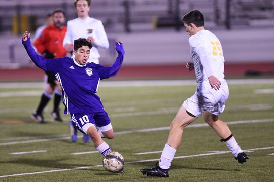 Wylie's Alen Canales (10) pokes the ball away from a Stephenville defender during the game at Bulldog Stadium on Friday, Feb. 7, 2020. The Bulldogs scored first, but fell 2-1 in their final nondistrict game.