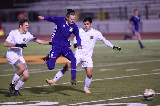 Wylie's Jaten Allen (6) jumps to avoid a leg as he splits a pair of Stephenville defenders at Bulldog Stadium on Friday, Feb. 7, 2020. The Bulldogs scored first, but fell 2-1 in their final nondistrict game.