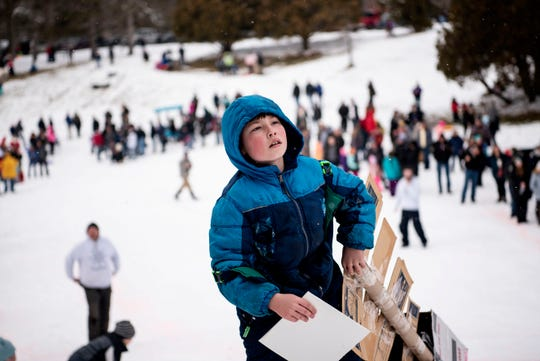 Ethan Dickert, 9, carries his sled during the Festivus 2020 Cardboard Sled Race on Saturday, Feb. 8 at Leila Arboretum in Battle Creek, Mich.