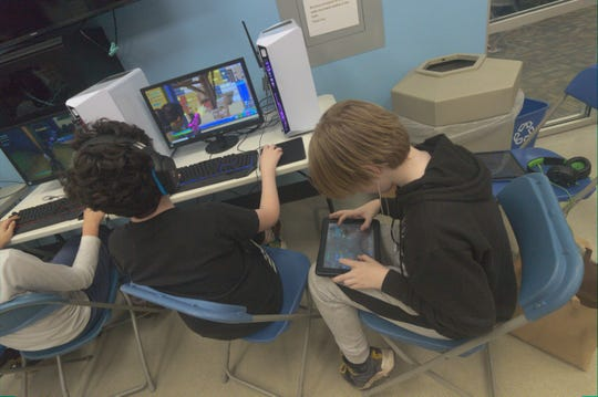 Young gamers play at the eSports club hosted by the Bainbridge Island Metropolitan Park and Recreation District on Friday, Feb. 7, 2020.