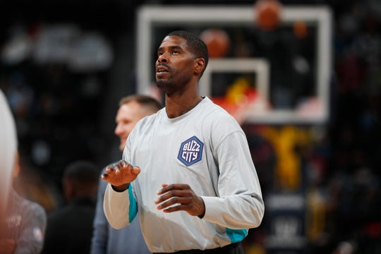 Charlotte Hornets forward Marvin Williams warms up before a  Jan. 15 game at Denver. The Bremerton High alum was waived by the Hornets and is expected to sign with the Milwaukee Bucks.