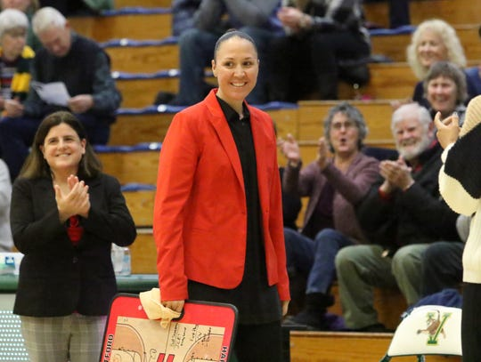Former Rice star Morgan Valley receives an ovation during pre game introductions. Valley made her return to Vermont as head coach of Hartford on Saturday at UVM's Patrick Gym. Valley and the Hawks came up short falling to 62-51 to the Catamounts.