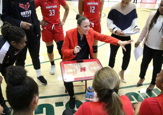 Former Rice star Morgan Valley gives her team instructions during a timeout. Valley made her return to Vermont as head coach of Hartford on Saturday at UVM's Patrick Gym. Valley and the Hawks came up short falling to 62-51 to the Catamounts.
