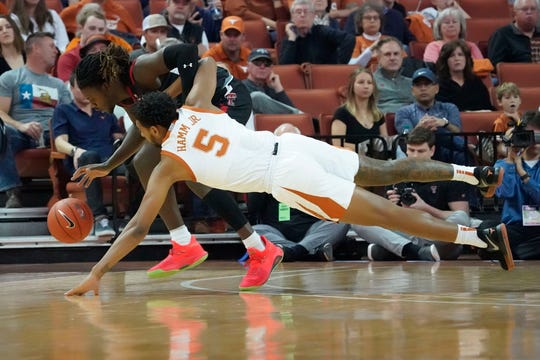 Feb 8, 2020; Austin, Texas, USA; Texas Longhorns forward Royce Hamm Jr. (5) dives for a loose ball with Texas Tech Red Raiders guard Chris Clarke in the first half at Frank C. Erwin Jr. Center. Mandatory Credit: Scott Wachter-USA TODAY Sports