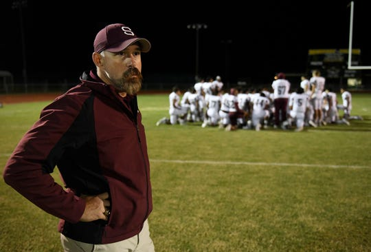 "Michael Troutman pauses after the team loss against Rockport-Fulton, Friday, Oct. 11, 2019, at Rockport. ""I do take it personal because it's not that it's about me wanting to win,"" Troutman says, ""I want those kids to win."""
