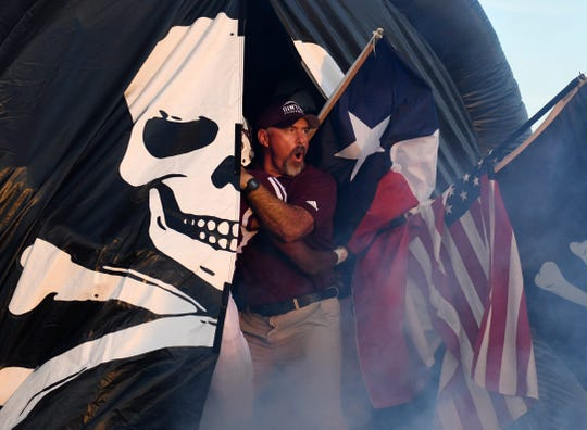 "Michael Troutman cheers with the football team before the game against La Vernia, Friday, Aug. 30, 2019, at Sinton High School. ""I don't know how many coaches run out of the darn tunnel, but I was feeling it so much,"" Troutman says about running with the team before their first game."