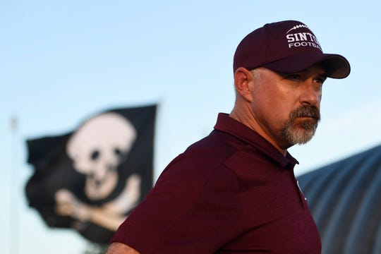 Michael Troutman pauses before his first game as head football coach and athlete director for Sinton High Schoo, Friday, Aug. 30, 2019, at Sinton High School. Troutman came from Klein Collins High School.