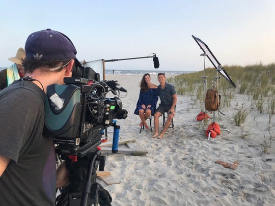 A cameraman films Stephanie and Stephen Scibal during a scene of 'Beachfront Bargain Hunt'.'