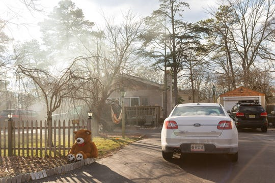Cars line the driveway of a Maricopa Trail home in Pemberton Township, on Saturday. A 4-year-old boy died in the home Friday evening after suffering an apparent self-inflicted gunshot wound to the head.