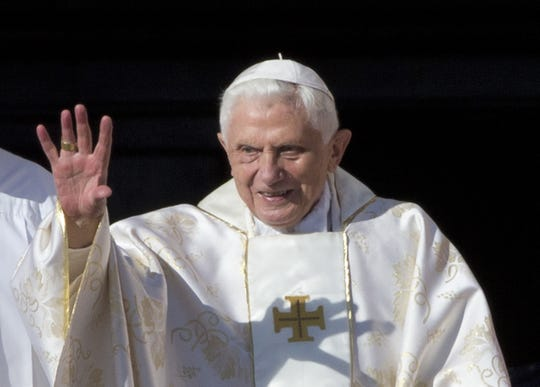 This Oct. 19, 2014 file photo shows Pope Emeritus Benedict XVI arrives in St. Peter's Square at the Vatican to attend the beatification ceremony of Pope Paul VI, and a mass for the closing of a two-week synod on family issues, celebrated by Pope Francis.