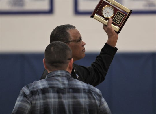 Simon Kenton head coach Jeff Stowers acknowledges the crowd as he was honored for a pair of career milestones, as Simon Kenton defeated Cooper 70-34 in girls basketball Feb. 7, 2020 at Simon Kenton High School, Independence, Ky. The Pioneers improved to 24-3 on the season.