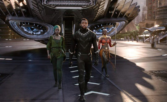 "Lupita Nyong'o (left), Chadwick Boseman and Danai Gurira star in the Marvel Studios film ""Black Panther."""