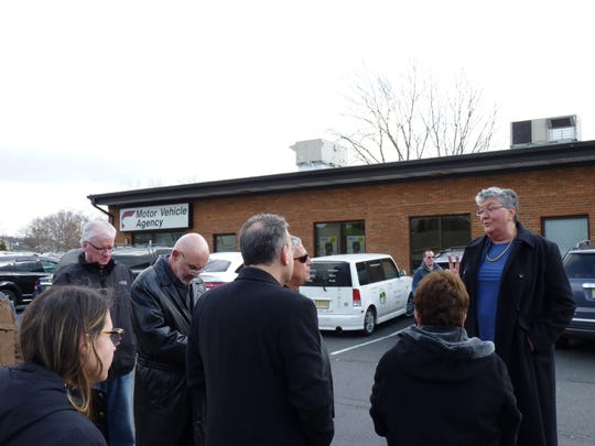 Local and state elected officials, joined by Somerville residents, met at the Motor Vehicle Commission's Somerville agency on Saturday with MVC's chief administrator Sue Fulton to discuss parking, congestion pollution and other issues concerning the community.