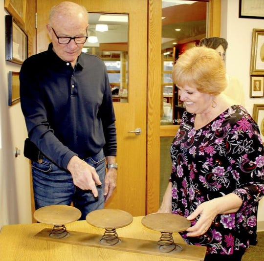 Jim Marks and Perri Sanders of White Pigeon Township Library discuss an item donated to the library years ago.