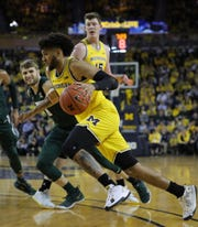 Michigan forward Isaiah Livers drives against Michigan State guard Kyle Ahrens during the first half Saturday, Feb. 8, 2020 at the Crisler Center in Ann Arbor.