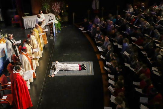 Dr. Bonnie Perry lays face down at the feet or Episcopal reverends during a service that will ordain her as the 11th bishop of the Episcopal Diocese of Michigan on February 8, 2020 at the Ford Community & Performing Arts Center in Dearborn, Mich. Perry will become the first woman bishop as well as the first lesbian bishop in the diocese since it was formed in 1836.