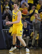 Michigan's Jon Teske celebrates after his second-half dunk against Michigan State on Saturday, Feb. 8, 2020 at the Crisler Center in Ann Arbor.