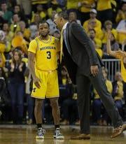 Michigan coach Juwan Howard talks to Zavier Simpson during action against Michigan State, Saturday, Feb. 8, 2020 at the Crisler Center in Ann Arbor.
