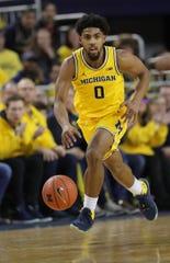 Michigan's David DeJulius brings the ball up court against Michigan State on Saturday, Feb. 8, 2020 at the Crisler Center in Ann Arbor.