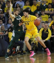 Michigan forward Brandon Johns Jr. is defended by Michigan State guard Kyle Ahrens on Saturday, Feb. 8, 2020 at the Crisler Center in Ann Arbor.