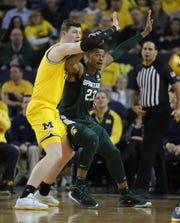 Michigan center Jon Teske defends Michigan State forward Xavier Tillman during the first half Saturday, Feb. 8, 2020 at the Crisler Center in Ann Arbor.