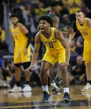 Michigan guard David DeJulius reacts after scoring against Michigan State during the first half Saturday, Feb. 8, 2020 at the Crisler Center in Ann Arbor.