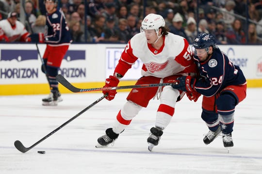 Detroit Red Wings' Tyler Bertuzzi carries the puck as Columbus Blue Jackets' Nathan Gerbe defends during the first period Friday, Feb. 7, 2020, in Columbus, Ohio.