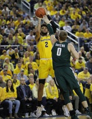 Isaiah Livers scores against MSU's Kyle Ahrens.