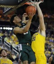 MSU's Malik Hall goes up against Michigan's Austin Davis on Feb. 8 in Ann Arbor.