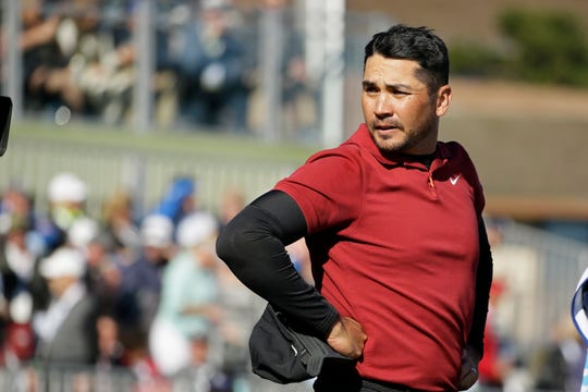 Jason Day, of Australia, stands on the 18th green of the Pebble Beach Golf Links after finishing the second round.