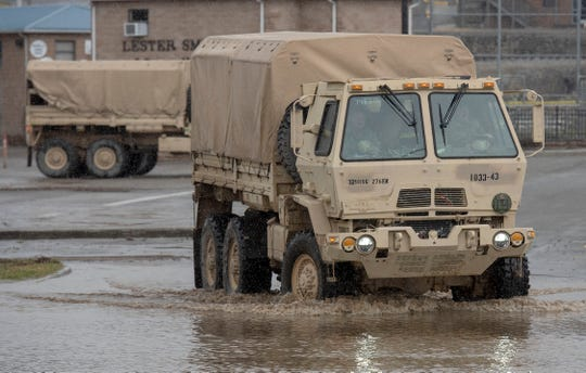 Virginia National Guard soldiers head out through standing water to deliver food and cleaning supplies to those in need Friday afternoon in Richlands, Va., Friday, Feb. 7, 2020, following flooding on Thursday after two days of rain.