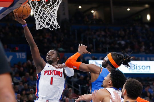 Pistons guard Reggie Jackson (1) shoots in front of Oklahoma City Thunder center Nerlens Noel, right, during Friday's game.