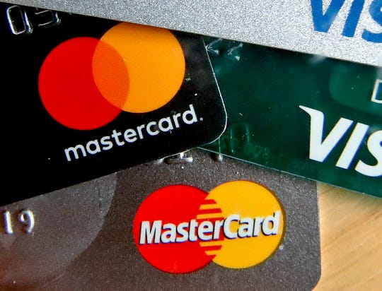 FILE - In this Feb. 20, 2019, file photo are Mastercard and Visa credit cards in Zelienople, Pa.