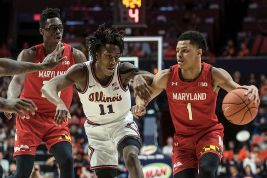 Maryland's Anthony Cowan Jr. (1) controls the ball as he is pressured by Illinois' Ayo Dosunmu (11) during the second half.