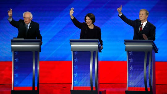 Democratic presidential candidates from left, Sen. Bernie Sanders, I-Vt., Sen. Amy Klobuchar, D-Minn., and businessman Tom Steyer try to be recognized during a Democratic presidential primary debate, Friday, Feb. 7, 2020, hosted by ABC News, Apple News, and WMUR-TV at Saint Anselm College in Manchester, N.H. (AP Photo/Elise Amendola)