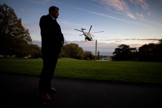 FIlE - In this Nov. 14, 2019, file photo a U.S. Secret Service special agent stands as Marine One, with President Donald Trump aboard, lifts off from the South Lawn of the White House in Washington.