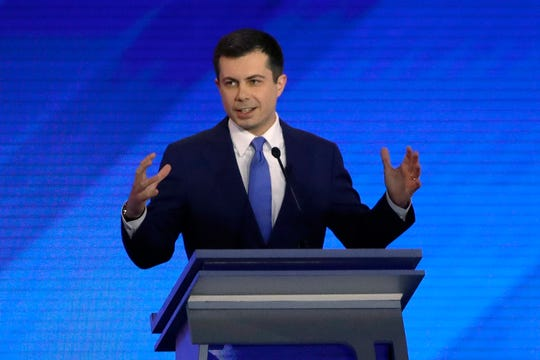 Democratic presidential candidate former South Bend, Ind., Mayor Pete Buttigieg speaks during a Democratic presidential primary debate, Friday, Feb. 7, 2020, hosted by ABC News, Apple News, and WMUR-TV at Saint Anselm College in Manchester, N.H. (AP Photo/Elise Amendola)