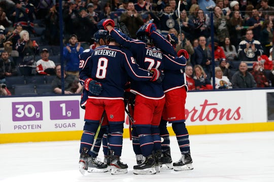 Columbus Blue Jackets celebrate a goal against the Red Wings during the second period.