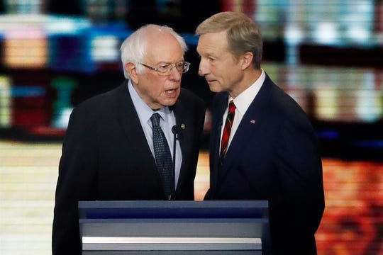 Democratic presidential candidates Sen. Bernie Sanders, I-Vt., left, and businessman Tom Steyer speak together during a break in a Democratic presidential primary debate, Friday, Feb. 7, 2020, hosted by ABC News, Apple News, and WMUR-TV at Saint Anselm College in Manchester, N.H. (AP Photo/Elise Amendola)