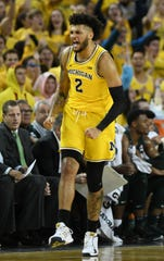 Michigan forward Isaiah Livers (2) reacts after hitting a 3-pointer in the first half on Saturday.