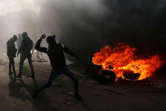Palestinians hurl stones towards Israeli soldiers during clashes after the funeral of policeman Tariq Badwan in the West Bank village of Azoun near Qalqilya, Friday, Feb. 7, 2020.