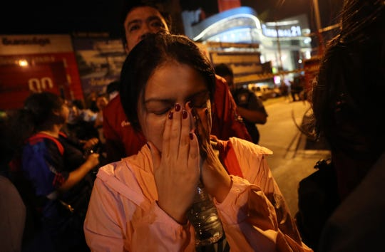 This woman was able to get out of Terminal 21 Korat mall in Nakhon Ratchasima, Thailand on Sunday, Feb. 9, 2020.